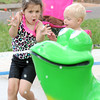Kloie Burch,4, braces for a cold splash as she plays with Zane Wehmeyer, 2 in the children's spray park at Parr Hill Park on Friday.<br /> Globe | Laurie Sisk