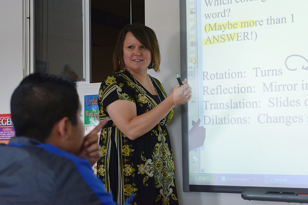 Globe/Roger Nomer<br /> Melissa Box teaches a math class for Hispanic students at Carthage Junior High.