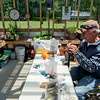 Globe/Roger Nomer<br /> Steve Bever ties a fly fishing lure in his greenhouse at his home at Crawford State Park on Thursday. Bever is a long-time resident at the lake.