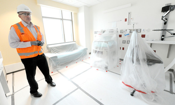 Mercy Hospital project manager John Farnen stands in one of the Natal Intensive Care Unit rooms at the new hospital during a tour of construction on Wednesday.<br /> Globe | Laurie Sisk