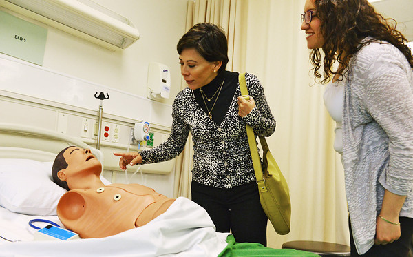 Globe/Roger Nomer<br /> Alicia Kerber, head consul of Mexico, Kansas City, left, and Lourdes Orestano, consul for community affairs, examine a patient dummy during a tour of Missouri Southern's Health Sciences building on Wednesday.