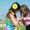 Globe/Roger Nomer<br /> Carl Junction second graders Joclyn Chambers, left, and Abby Searle examine names on their length of chain on Thursday morning.