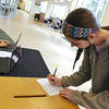 Globe/Roger Nomer<br /> Monica White, a Missouri Southern freshman from Bella Vista, Ark., fills out her ballot during Wednesday's election.
