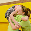 Globe/Roger Nomer<br /> McCune sixth graders (from left) Madison Stephens, Miranda Hartman and Abby Long share a group hug during the last school day at McCune Elementary on Tuesday.