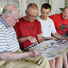 Globe/Roger Nomer<br /> (from left) Joplin resident Henry Robertson, Dale and Mitchell Spence, Halifax, Nova Scotia, and Wayne Arrowsmith, Quispamsis, New Brunswick, look over a map of the group's progress along Route 66 on Tuesday evening.