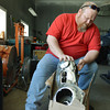 Globe/Roger Nomer<br /> Danny Fleming, owner of DNA Performance Cycles, sorts through salvaged parts from his store in Baxter Springs on Wednesday afternoon.