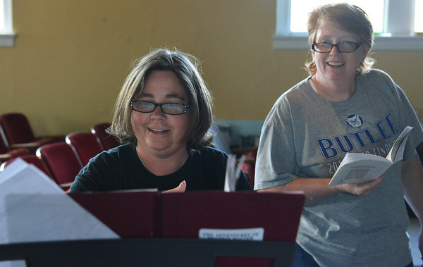 "Globe/Roger Nomer<br /> Music Director Jill Spencer, left, and Director Tammy Aggus make notes during rehearsal for ""The Adventures of Beatrix Potter and Her Friends"" at Joplin's Stained Glass Theatre on Monday evening."