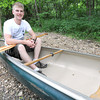 Recent Webb City High School graduate James Wellborn sits inside the canoe that he hopes will take him on a more than 2,000 mile journey down the entire Mississippi River.<br /> Globe | Laurie Sisk