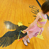 Globe/Roger Nomer<br /> Kyree Brooks, first grader, jumps rope over the McCune Eagle mascot on Tuesday afternoon.