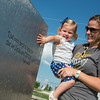 Globe/Roger Nomer<br /> Jenny and Julie Glenn, 1, look at one of several water features in the memorial butterfly garden at Cunningham Park on Thursday evening.