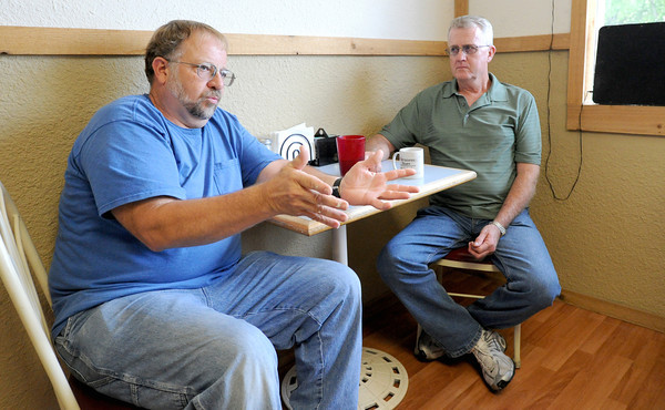 Tom Goff, left and Duane Davis discuss the importance of attracting new businesses to the tiny town of McCune, Kan. on Friday while sitting in one of the town's few businesses, The Cup O Coffee Cafe. Davis is a lifetime resident of McCune and Goff has lived in the town of about 400 people for the past 30 years.<br /> Globe | Laurie Sisk