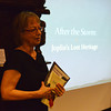 "Globe/Roger Nomer<br /> Leslie Simpson, director of the Post Memorial Art Reference Library, gives a presentation called ""After the Storm:  Joplin's Lost Heritage"" on Tuesday afternoon. The presentation on Joplin structures lost in the tornado runs through Friday at 12:15 p.m. daily at the library."