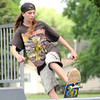 Josh Quinn, 16 takes his turn down the ramp at the skate park at Schifferdecker on Friday. quinn said he would like to see Joplin expand the park beyond the one ramp.<br /> Globe | Laurie Sisk