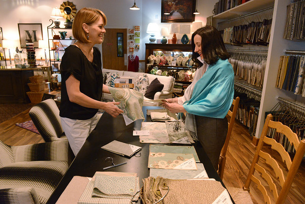 Globe/Roger Nomer<br /> Amber Sachetta, left, and Pam Mense talk about fabric design in their new location of Madison Lane Interiors on Thursday.