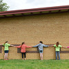Globe/Roger Nomer<br /> McCune Elementary students hold hands as they line up around the school building to give it a hug goodbye on Tuesday.