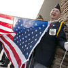 Globe/Roger Nomer<br /> Ralph Green helps the Joplin American Legion Post 13 raise the flag at the new Wal-Mart Neighborhood Market on Thursday.
