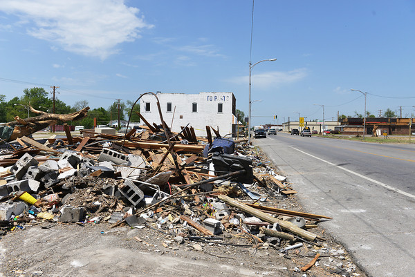 Globe/Roger Nomer<br /> The debris is all that remains from several businesses along Military Avenue in Baxter Springs.
