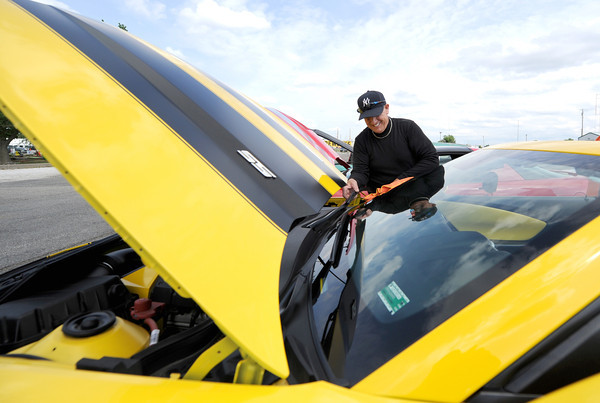 Jeff Mertens polishes his 2010 Chevy Camaro SS Convertible during a Route 66 Cruise Nite on Saturday at Carousel Park. The Camaro is just one of two in existence and was built to push more than 400 horsepower.<br /> Globe | Laurie Sisk