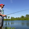 Globe/Roger Nomer<br /> Sam Moore, a Pittsburg State sophomore from Springfield, fishes at a mined land wildlife area near Springfield on May 6, 2014.