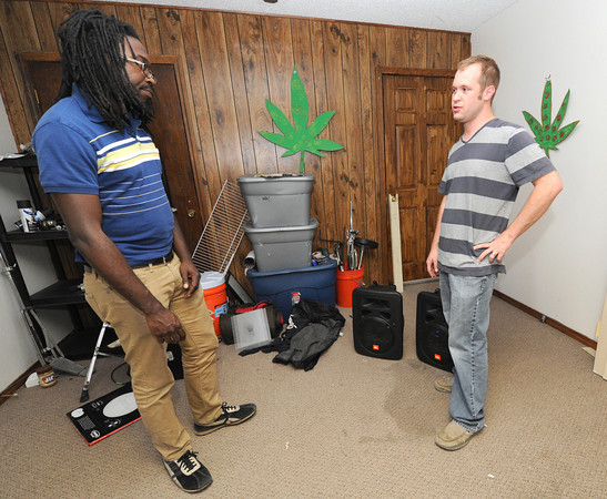 Third Party drummer Greg Walker, left and bass player Kelly Maddy stand near the few items not taken by burglars during a break-in Sunday night at the band's practice space on Ohio street. <br /> Globe | Laurie Sisk
