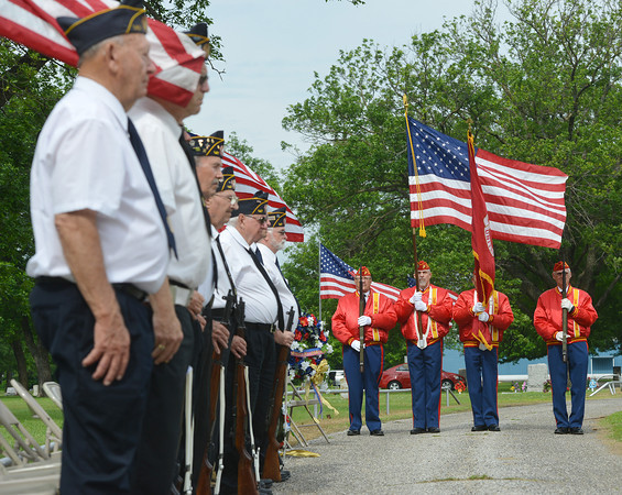 Globe/Roger Nomer<br /> The Marine Corp League presents the colors during a Memorial Day ceremony at the Grand Army of the Republic Cemetery in Miami on Monday.