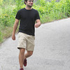 Jeremy Harmon enjoys a walk along the Wildcat Glades Trail under Reddings Mill Bridge on Thursday.<br /> Globe | Laurie Sisk