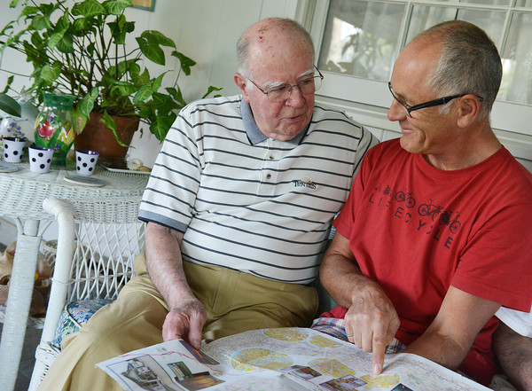 Globe/Roger Nomer<br /> Henry Robertson and Dale Spence, Halifax, Nova Scotia, look over a map of Spence's progress on Route 66 on Tuesday evening.
