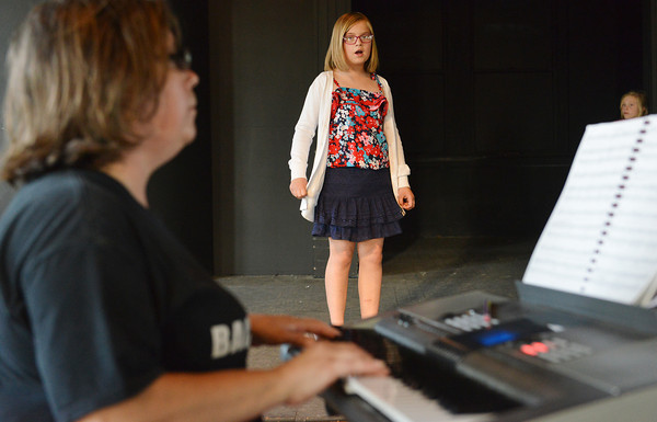 """Globe/Roger Nomer<br /> Jill Spencer accompanies Caroline Hunter, 10, during rehearsal for """"The Adventures of Beatrix Potter and Her Friends"""" at Joplin's Stained Glass Theatre on Monday evening."""