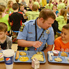 Globe/Roger Nomer<br /> Crawford County Sheriff's Deputy and School Resource Officer Dallas Pulliam has lunch with McCune Elementary students on the last day of class.