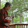 Globe/Roger Nomer<br /> Tim Anderson practices his mandolin on the campus of Pittsburg State University on Tuesday.