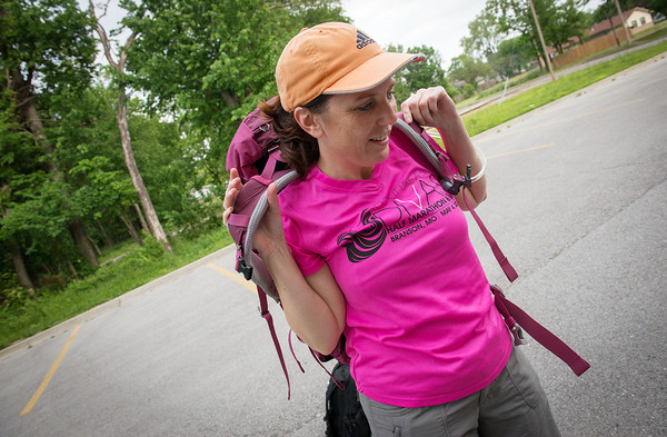 Globe/Roger Nomer<br /> Anne Windsor, Joplinl, prepares her pack for hike at the Frisco Trail on Wednesday.