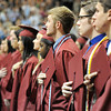Joplin High School graduates place their hands to their hearts for the playing of the Star Spangled Banner during graduation  ceremonies on Sunday at the Leggett & Platt Athletic Center.<br /> Globe | Laurie Sisk