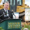 Missouri Southern State University Vice President for Student Affairs Darren Fullerton talks about the new West Plaza Residence Hall project at MSSU during a groundbreaking ceremony on Thursday. The apartment-like dwellings will house about 200 additional students and is expected to be completed in 2015.<br /> Globe | Laurie Sisk