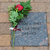Globe/Roger Nomer<br /> A flower lays on a paver dedicated to Richard Jones at the Pittsburg State Veterans Memorial on Monday.