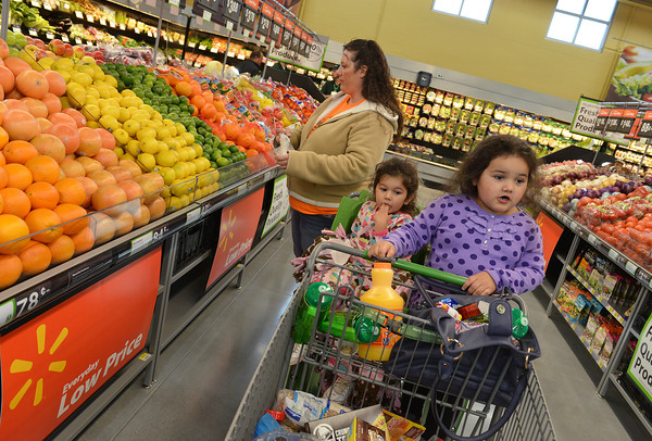 Globe/Roger Nomer<br /> Joselyn, 3, and Adriana, 4, Reyna check out the new Wal-Mart Neighborhood Market as their mom Anna shops on Thursday.