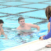 From the left: Tanner McMurtrey, Matt Kersey and Korra Ackerson clean debris from the bottom of Schifferdecker Pool last week in preparation for opening of the pool.<br /> Globe | Laurie Sisk