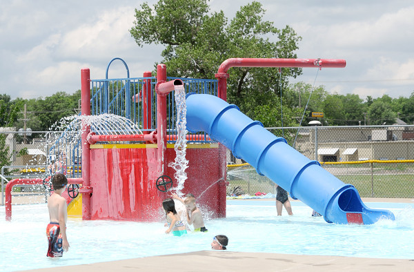 Children cool off near one of the waterslides at the Ewert Family Aquatics Center on Saturday.<br /> Globe | Laurie Sisk