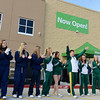 Globe/Roger Nomer<br /> Joplin High and Missouri Southern cheer squads lead the crowd in the Wal-Mart cheer to open the new Neighborhood Market on Thursday.