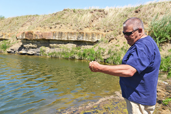 Globe/Roger Nomer<br /> Tom Pebley, Basehor, Kan., baits his hook while fishing at a mined wildlife area near West Mineral on May 6, 2014.