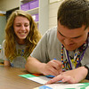 Globe/Roger Nomer<br /> Sarah Jewett and Bryce Commons color during the last hour of school at Pittsburg High School on Tuesday.