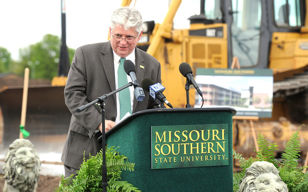Missouri Southern State University Interim President Alan Marble details the advantages of the new West Plaza Residence Hall project at MSSU. The apartment-like dwellings will house about 200 additional students and is expected to be completed in 2015.<br /> Globe | Laurie Sisk