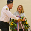 "Globe/Roger Nomer<br /> Don Morey assists Judith Avila with a wreath during a Memorial Day event at Pittsburg State on Monday. Avila is the co-author of ""Code Talker:  The First and Only Memoir By One of the Original Navajo Code Talkers of WWII."""