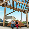 Globe/Roger Nomer<br /> Under a canopy designed to mirror the tornado's path through Jjoplin, Mark and Paula Callihan, Joplin, pause to write in a journal attatched to a bench at the butterfly garden. The Callihans volunteered with the building of the garden.
