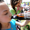 Pittsburg Lakeside fourth grader Alexis Gawlas enjoys a souvenir root beer at Nelson's Old Country Store in Riverton as part of a Route 66 tour on Thursday.<br /> Globe | Laurie Sisk