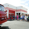 From the left: Lakeside fourth graders and their chaperones check out Coars on the Route in Galena as part of a Route 66 tour on Thursday.<br /> Globe | Laurie Sisk