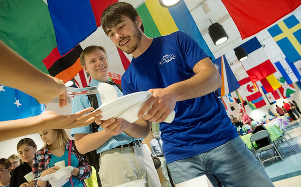 Globe/Roger Nomer<br /> Jeremiah Rittenhouse, a Crowder freshman from Wheaton, left, and Alec Fehring, a freshman from Neosho, sample Sweet Coconut Rice during Monday's International Food Festival at Crowder College.