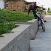 Globe/Roger Nomer<br /> Tamara Comer's grandson Kyler Palmer, 7, jumps off his bike at her house on Thursday, April 21. Although the neighborhood was empty when she rebuilt, now it has come back to life. Children play on the sidewalks, and houses fill the previously empty lots.