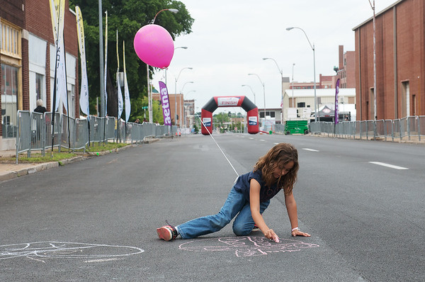 Globe/Roger Nomer<br /> Mylee Hatfield, 8, leaves a message for walkers before Friday's Walk of Silence.