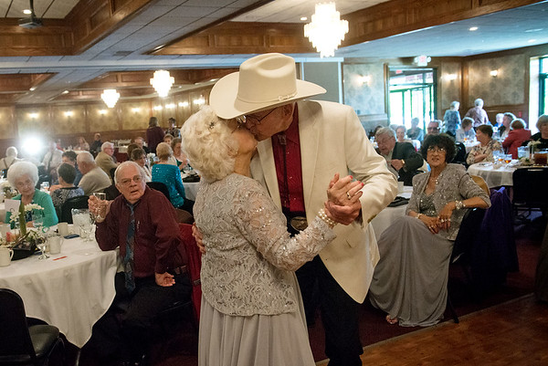 Globe/Roger Nomer<br /> Tommy Thompson and Joan McMullen Thompson share a kiss on the dance floor during Wednesday's Senior Prom held by the Area Agency on Aging at the Butcher's Block Event Center. The couple was named king and queen of the prom.