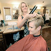 Cut Loose Salon stylist Emily Carden works with client Jennifer Pritchard at the salon.<br /> Globe | Laurie Sisk